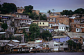 Manaus, Brazil. Poor riverside area of the city with wooden houses on stilts.