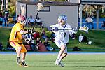 Rancho Santa Margarita, CA 04/30/10 - Hayden Ruiz (Santa Margarita #19) and Max Myrick (Torrey Pines #9) in action during the Rancho Santa Margarita CHS-Torrey Pines boys varsity lacrosse game.