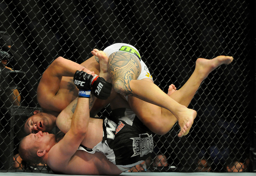 24 SEPTEMBER 2011:  Travis Browne grapples with Rob Broughton   during UFC 135 at the Pepsi Center in Denver, Colorado. *****For Editorial Use Only*****