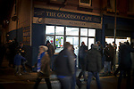 Spectators walking past a cafe outside Goodison Park, Liverpool before the Premier League match between Everton and West Bromwich Albion. The match ended in a 0-0 draw, despite the home team missing a first-half penalty by Kevin Mirallas. The game was watched by 34,739 spectators and left both teams languishing near the relegation zone.