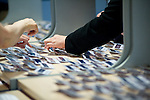 Photograph of hands and registration badges at a corporate conference in London