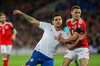James Chester of Wales holds off Aleksandar Mitrovic of Serbia during the FIFA World Cup Qualifying match between Wales and Serbia at the Cardiff City Stadium, Cardiff, Wales on 12 November 2016. Photo by Mark  Hawkins.