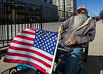 Veteran Lewis Tucker watches the Reno Rodeo Parade on Saturday, June 22, 2019.