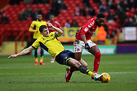 John Mousinho of Oxford United tackles Charlton's Tariqe Fosu during Charlton Athletic vs Oxford United, Sky Bet EFL League 1 Football at The Valley on 3rd February 2018
