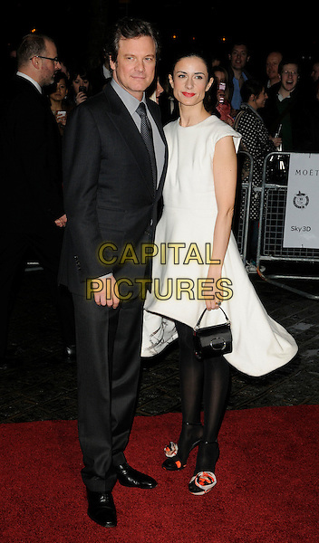 COLIN FIRTH & LIVIA GIUGGIOLI.London Critics' Circle Film Awards at BFI Southbank, London, England..February 10th 2011.ALFS full length black white suit sleeveless dress tights married husband wife handbag .CAP/CAN.©Can Nguyen/Capital Pictures.