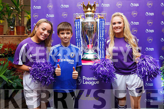 Ella Scanlon, Katie Walsh and Daniel Sheehy from Annagh pictured with the Premier League Cup in SuperValu Tralee on Wednesday afternoon.