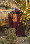 Red painted metal covered outhouse, Randsburg, Calif.