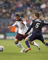 Colorado Rapids forward Caleb Folan (21) dribbles as New England Revolution defender A.J. Soares (5) defends. In a Major League Soccer (MLS) match, the New England Revolution tied the Colorado Rapids, 0-0, at Gillette Stadium on May 7, 2011.