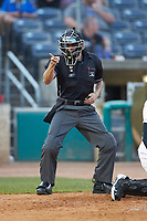 Home plate umpire Kelvis Velez makes a strike call during the South Atlantic League game between the Lexington Legends and the West Virginia Power at Appalachian Power Park on June 7, 2018 in Charleston, West Virginia. The Power defeated the Legends 5-1. (Brian Westerholt/Four Seam Images)
