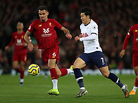 27th October 2019; Anfield, Liverpool, Merseyside, England; English Premier League Football, Liverpool versus Tottenham Hotspur; Dejan Lovren of Liverpool and Son Heung-Min of Tottenham Hotspur compete for the ball  - Strictly Editorial Use Only. No use with unauthorized audio, video, data, fixture lists, club/league logos or 'live' services. Online in-match use limited to 120 images, no video emulation. No use in betting, games or single club/league/player publications