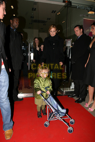 CAT DEELEY.Kiss It Better - Instyle campaign launch party.Space NK, Kings Road.08 March 2004.funny, child, pushchair.www.capitalpictures.com.sales@capitalpictures.com.© Capital Pictures.