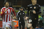 Home manager Tony Pulis watching the action in the first half from the side of the pitch at the Britannia Stadium, Stoke-on-Trent, during the UEFA Europa League last 32 first leg between Stoke City and visitors Valencia. The match ended in a 1-0 victory from the visitors from Spain. Mehmet Topal scored the only goal in the first half in a match watched by a crowd of 24,185.