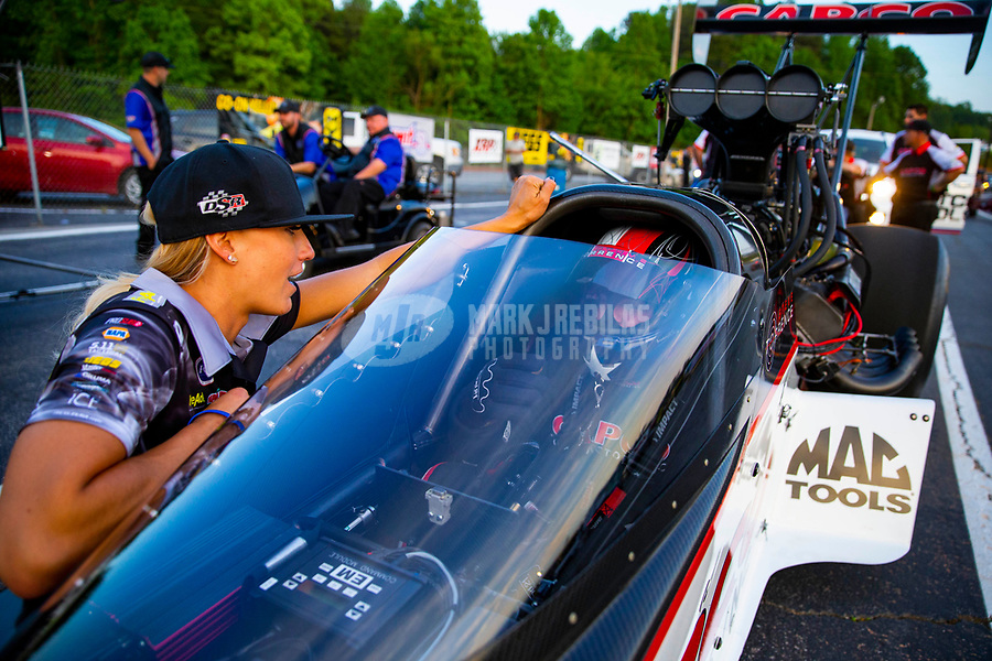 May 4, 2018; Commerce, GA, USA; NHRA top fuel driver Leah Pritchett (left) talks with Steve Torrence during qualifying for the Southern Nationals at Atlanta Dragway. Mandatory Credit: Mark J. Rebilas-USA TODAY Sports