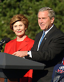 United States President George W. Bush and first lady Laura Bush make remarks to the 2004 United States Olympic and Paralympic teams on the South Lawn of the White House in Washington, D.C. on October 18, 2004.  <br /> Credit: Ron Sachs / CNP