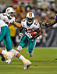 7 December 2008: Miami Dolphins' running back Ronnie Brown gains yardage in the third quarter against the Buffalo Bills during the first regular season NFL game ever to be played in Canada. The Dolphins defeated the Bills 16-3 at the Rogers Centre in Toronto, Ontario. ..Mandatory Photo Credit: Ed Wolfstein Photo