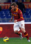 Calcio, Serie A: Roma vs Fiorentina. Roma, stadio Olimpico, 8 dicembre 2012..AS Roma midfielder Daniele De Rossi in action during the Italian Serie A football match between AS Roma and Fiorentina at Rome's Olympic stadium, 8 december 2012..UPDATE IMAGES PRESS/Isabella Bonotto