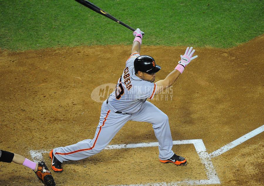 May 13, 2012; Phoenix, AZ, USA; San Francisco Giants batter Melky Cabrera hits an RBI single in the third inning against the Arizona Diamondbacks at Chase Field. Mandatory Credit: Mark J. Rebilas-