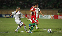Hungary's Krisztian Nemeth (9) has the back of his shoe stepped on by Italy's Marco Calderoni (6) during a drive to the goal during the FIFA Under 20 World Cup Quarter-final match at the Mubarak Stadium  in Suez, Egypt, on October 09, 2009. Hungary won 2-3 in overtime.