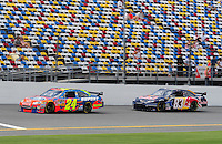 Jul. 3, 2008; Daytona Beach, FL, USA; NASCAR Sprint Cup Series driver Jeff Gordon (24) leads Brian Vickers (83) during practice for the Coke Zero 400 at Daytona International Speedway. Mandatory Credit: Mark J. Rebilas-