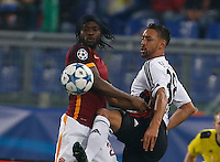 AS Roma's Gervinho  fight for the ball with Leverkusen's Karim Bellarabi  during the Champions League Group E soccer match between As Roma and  Bayer Leverkusen at the Olympic Stadium in Rome, November 04 2015