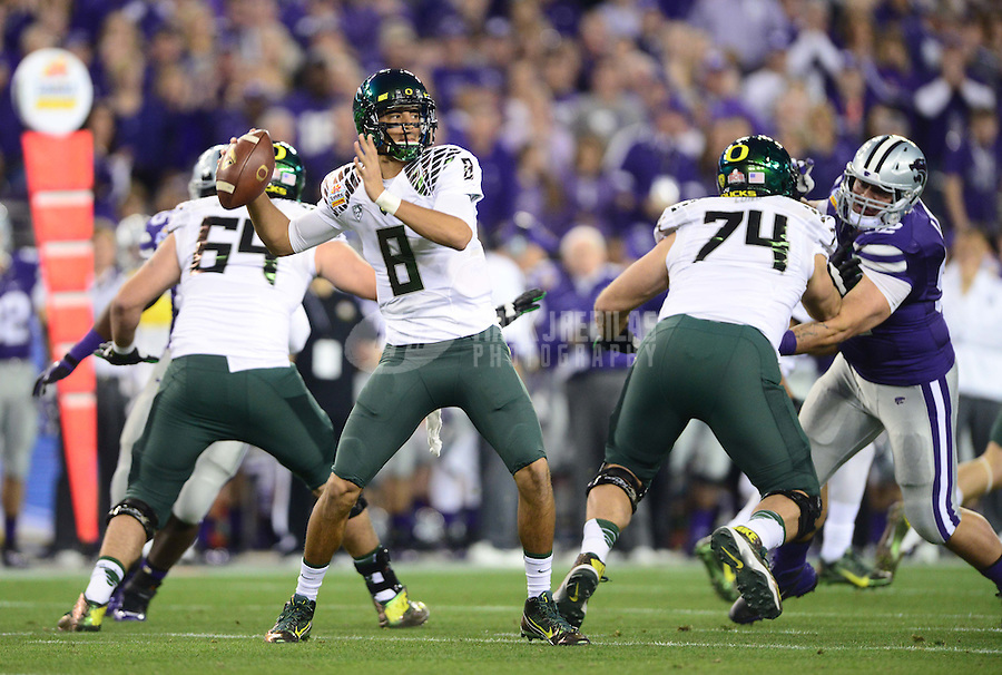 Jan. 3, 2013; Glendale, AZ, USA: Oregon Ducks quarterback Marcus Mariota (8) throws a pass in the first quarter against the Kansas State Wildcats during the 2013 Fiesta Bowl at University of Phoenix Stadium. Mandatory Credit: Mark J. Rebilas-