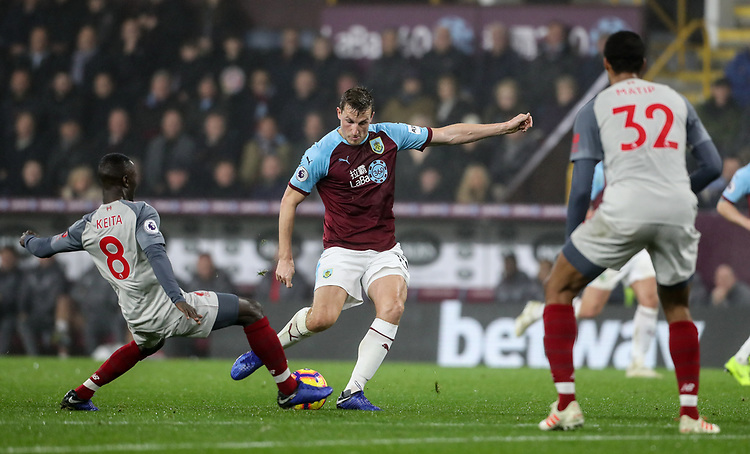 Burnley's Chris Wood shoots under pressure from Liverpool's Naby Keita<br /> <br /> Photographer Andrew Kearns/CameraSport<br /> <br /> The Premier League - Burnley v Liverpool - Wednesday 5th December 2018 - Turf Moor - Burnley<br /> <br /> World Copyright &copy; 2018 CameraSport. All rights reserved. 43 Linden Ave. Countesthorpe. Leicester. England. LE8 5PG - Tel: +44 (0) 116 277 4147 - admin@camerasport.com - www.camerasport.com