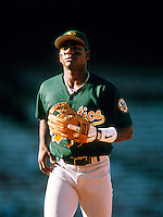 Miguel Tejada of the Oakland Athletics during a game at Anaheim Stadium in Anaheim, California during the 1997 season.(Larry Goren/Four Seam Images)