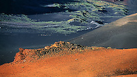 The landscape of the crater in HALEAKALA NATIONAL PARK on Maui in Hawaii arid and rugged