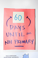 """A sign reading """"60 Days Until the NH Primary"""" hangs on a wall in the campaign headquarters of Kentucky senator and Republican presidential candidate Rand Paul in Manchester, New Hampshire."""