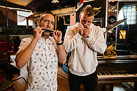 Carolina Panthers Running Back Christian McCaffrey (right) plays harmonica music with ESPN Hang Time host Sam Alipour at The Decibel Garden in Denver, Colorado, Wednesday, June 26, 2019.<br />  <br /> Photo by Matt Nager