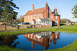 Traditional red brick farmhouse and farmyard water pond, Lux Farm, Kesgrave, Suffolk, England