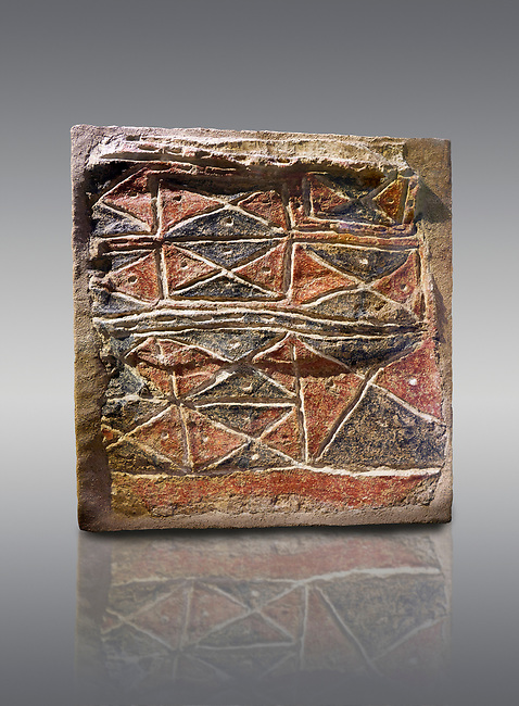 Wall fresco of geometric red and black triangles which appears to be a rug pattern copy. 6000 BC. . Catalhoyuk Collections. Museum of Anatolian Civilisations, Ankara. Against a grey background