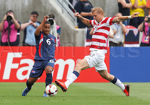 13.07.2013. Sandy, Utah, USA. Cuba defender Joel Colome (6) tries to get the ball past the defense of US Men's National midfielder Josh Gatt (23) during the CONCACAF Gold Cup soccer match between USA Men's National team and Cubaat Rio Tinto Stadium in Sandy, UT. USA.