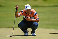 Hideki Matsuyama (JPN) lines up his putt on 1 during round 1 of the WGC FedEx St. Jude Invitational, TPC Southwind, Memphis, Tennessee, USA. 7/25/2019.<br /> Picture Ken Murray / Golffile.ie<br /> <br /> All photo usage must carry mandatory copyright credit (© Golffile | Ken Murray)
