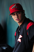 Tyler Beede (18) of the Richmond Flying Squirrels sits in the dugout during a game versus the New Hampshire Fisher Cats at Northeast Delta Dental Stadium in Manchester, New Hampshire on June 5, 2015.  (Ken Babbitt/Four Seam Images)