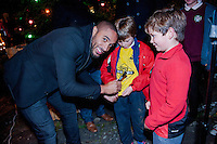 Thursday 20 November 2014<br /> Pictured: Ashley Williams signs some young fans' shirts  <br /> Re: Swansea City Captain Ashley Williams helps turn on the Christmas Lights at The Mumbles, Near Swansea, Wales UK