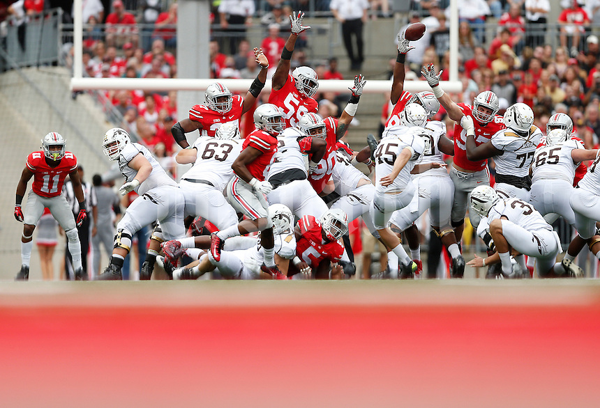 Western Michigan Broncos place kicker Andrew Haldeman (45) misses a field goal under pressure from the Ohio State Buckeyes defense in the second quarter of the college football game between the Ohio State Buckeyes and the Western Michigan Broncos at Ohio Stadium in Columbus, Saturday afternoon, September 26, 2015. At half time the Ohio State Buckeyes led Western Michigan Broncos 24 - 6. (The Columbus Dispatch / Eamon Queeney)