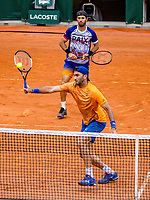 Paris, France, 3 june, 2019, Tennis, French Open, Roland Garros, Mens doubles: Jean Julien Rojer (NED) (background) and Horia Tacau (ROU)<br /> Photo: Henk Koster/tennisimages.com