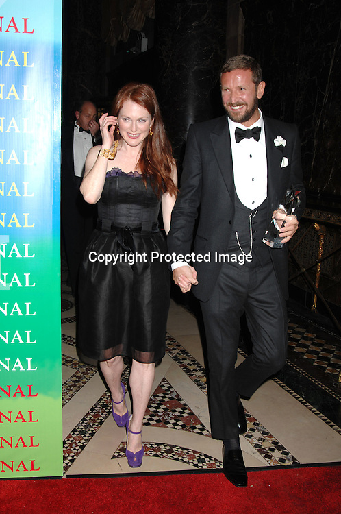 Julianne Moore and Stefano Pilati of Yves Saint Laurent..at The Fashion Group International 's Night of Stars Gala ..on October 26, 2006 at Cipriani 42nd Street. ..Robin Platzer, Twin Images