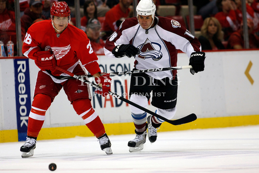 12 October 2010: Detroit Red Wings forward Jiri Hudler (26) and Colorado Avalanche forward Brandon Yip (18) pursue the puck in the first period of the Colorado Avalanche at Detroit Red Wings NHL hockey game, at Joe Louis Arena, in Detroit, MI...***** Editorial Use Only *****
