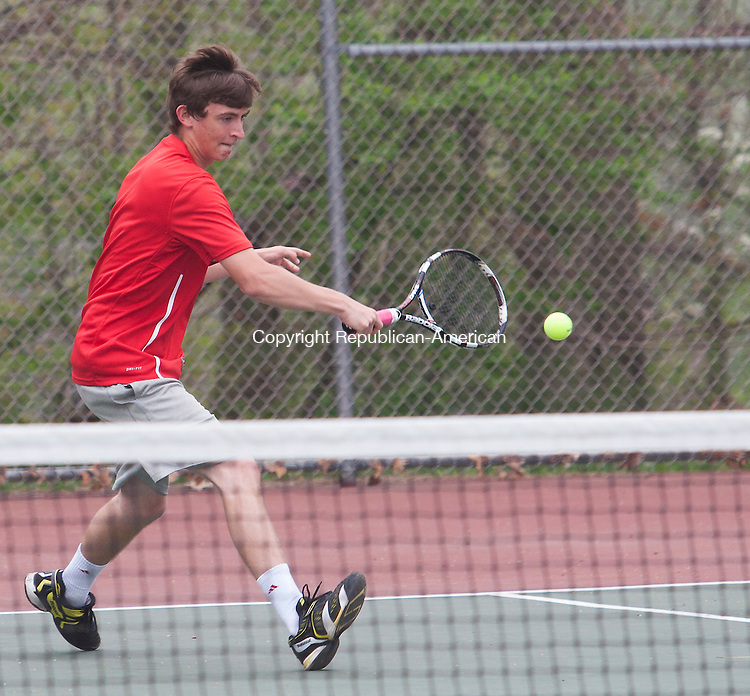WOLCOTT, CT - 09 APRIL 2015 - 050915JW07.jpg -- Ryan Collins of Wolcott returns against Ivo Wednt of Naugatuck during NVL match at Wolcott Saturday morning. Jonathan Wilcox Republican-American