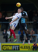 Caolan Lavery of Portsmouth & Anthony Stewart of Wycombe Wanderers go up for the ball during the Sky Bet League 2 match between Wycombe Wanderers and Portsmouth at Adams Park, High Wycombe, England on 28 November 2015. Photo by Andy Rowland.