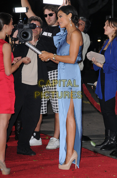 """ROSARIO DAWSON.attends the Twentieth Century Fox's L.A. Premiere of """"Unstoppable"""" held at Regency Village Theater in Westwood, California, USA, October 26th 2010..full length dress blue one shoulder side slit split beige nude platform shoes heels                                                                                  microphone holding .CAP/RKE/DVS.©DVS/RockinExposures/Capital Pictures."""