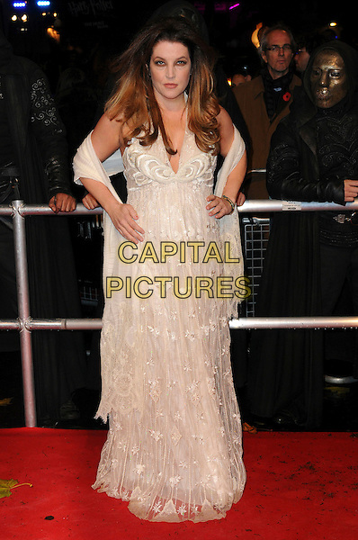 "LISA MARIE PRESLEY .""Harry Potter And The Deathly Hallows: Part 1"" World Film Premiere, Empire cinema Leicester Square and Odeon Leicester Square, London, England, UK, 11th November 2010. .full length cream white lace long maxi dress hands on hips wrap shawl halterneck .CAP/CAS.©Bob Cass/Capital Pictures."