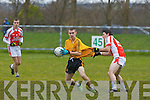 Bryan Murphy of Listowel Emmets in the thick of the action, having his jersey pulled by Tom McGoldrick of Brosna.