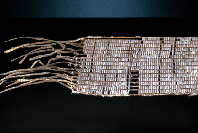 Wampum beads are made from quahog clam shells and are used as ornaments and money. The beads would be woven using string and leather to make belts and sashes by the Northeastern tribes such as the Shawnee.