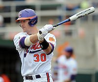Clemson catcher Doug Hogan bats in a game between the Clemson Tigers and Mercer Bears on Feb. 24, 2008, at Doug Kingsmore Stadium in Clemson, S.C. Photo by: Tom Priddy/Four Seam Images