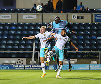 Adebayo Akinfenwa of Wycombe Wanderers wins an aerial battle during the The Checkatrade Trophy match between Wycombe Wanderers and West Ham United U21 at Adams Park, High Wycombe, England on 4 October 2016. Photo by David Horn.