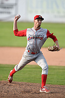 Williamsport Crosscutters pitcher Calvin Rayburn (26) delivers a pitch during the first game of a doubleheader against the Batavia Muckdogs on July 29, 2014 at Dwyer Stadium in Batavia, New York.  Williamsport defeated Batavia 3-2.  (Mike Janes/Four Seam Images)