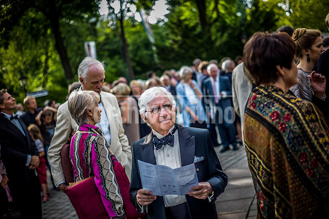 Bayreuth Germany; august 2013; People attending at the Wagner Festival.The Bayreuth Festival is dedicated exclusively to representing the music dramas of Richard Wagner, who founded it in 1876. Since then, there have been year after year almost uninterrupted different editions of the festival, which takes place in summer, representing ten of the German composer's music dramas. Since its founding, the Festival has been in charge of a family member Wagner, being the current chief executive Wolfgang Wagner, grandson of musician.<br /> Every summer Bayreuth becomes the reference point Wagnerian world, and the waiting list to attend any of the performances that take place there is several años.En 70,000 people live Bayreuth Festival and has 30 functions with nearly 2,000 people function. So there are nearly 60,000 people coming in 5 weeks to see the operas.